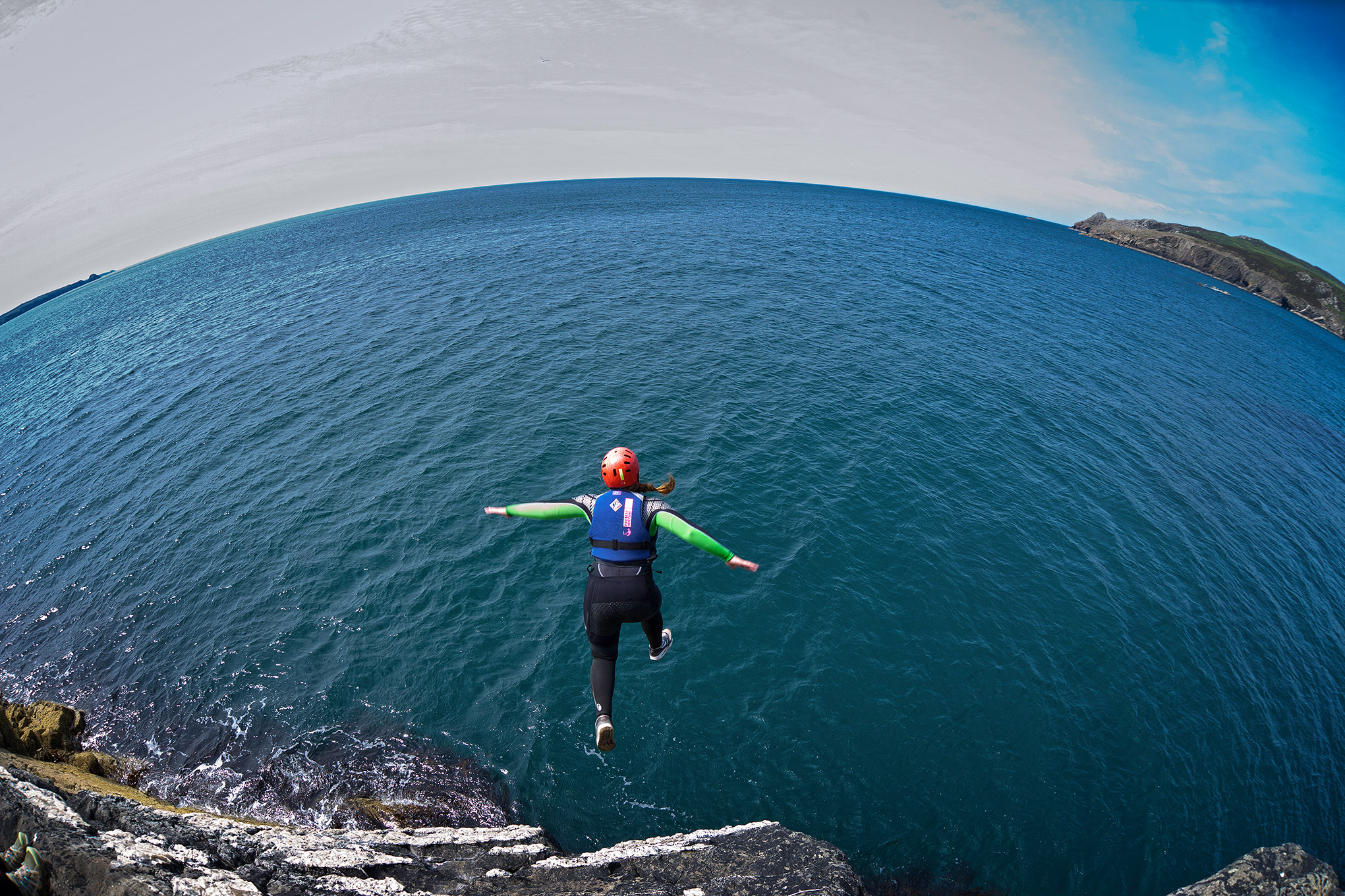 Jumping into the sea Coasteering North Pembrokeshire South Activities and Sports